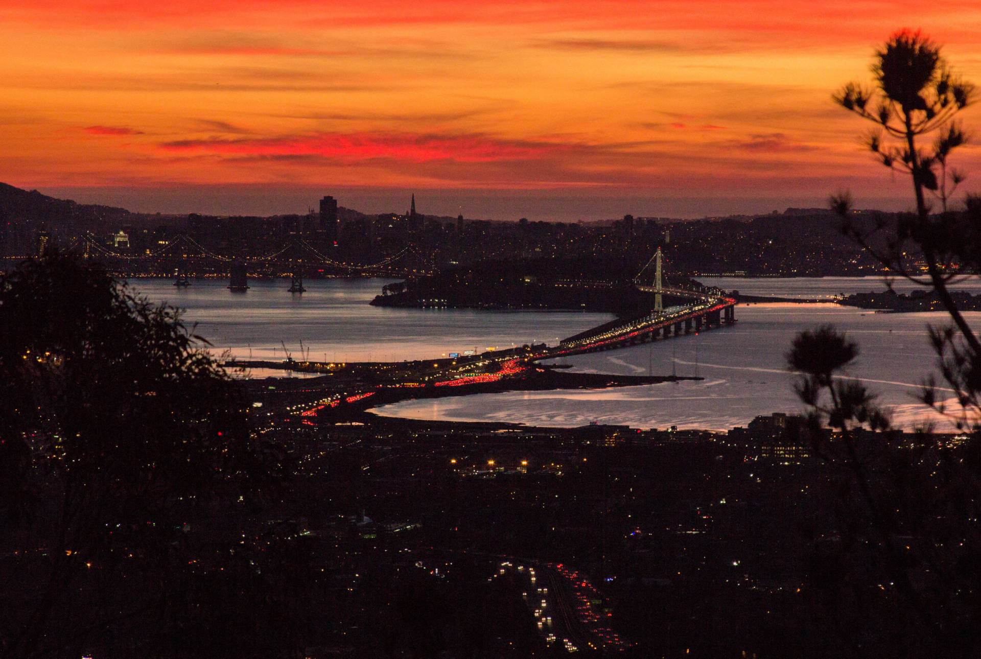 A 2015 (pre-Salesforce Tower) view from Grizzly Peak Boulevard in the Oakland Hills featuring jammed Saturday night traffic at the Bay Bridge Toll Plaza.  Dan Brekke/KQED