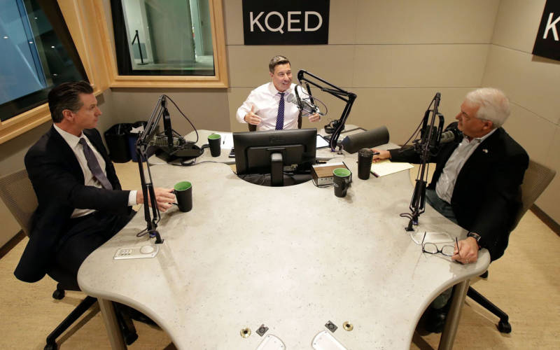 Gavin Newsom (L) and John Cox (R) join KQED's Scott Shafer for their only scheduled gubernatorial debate in KQED's San Francisco studios on Oct. 8, 2018.