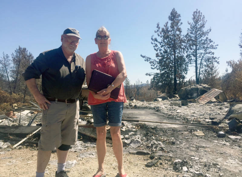 Jim and Donna Dowling stand in front of the rubble that used to be the home they built from scratch 25 years ago outside Redding. It burned down in the Carr Fire in late July.