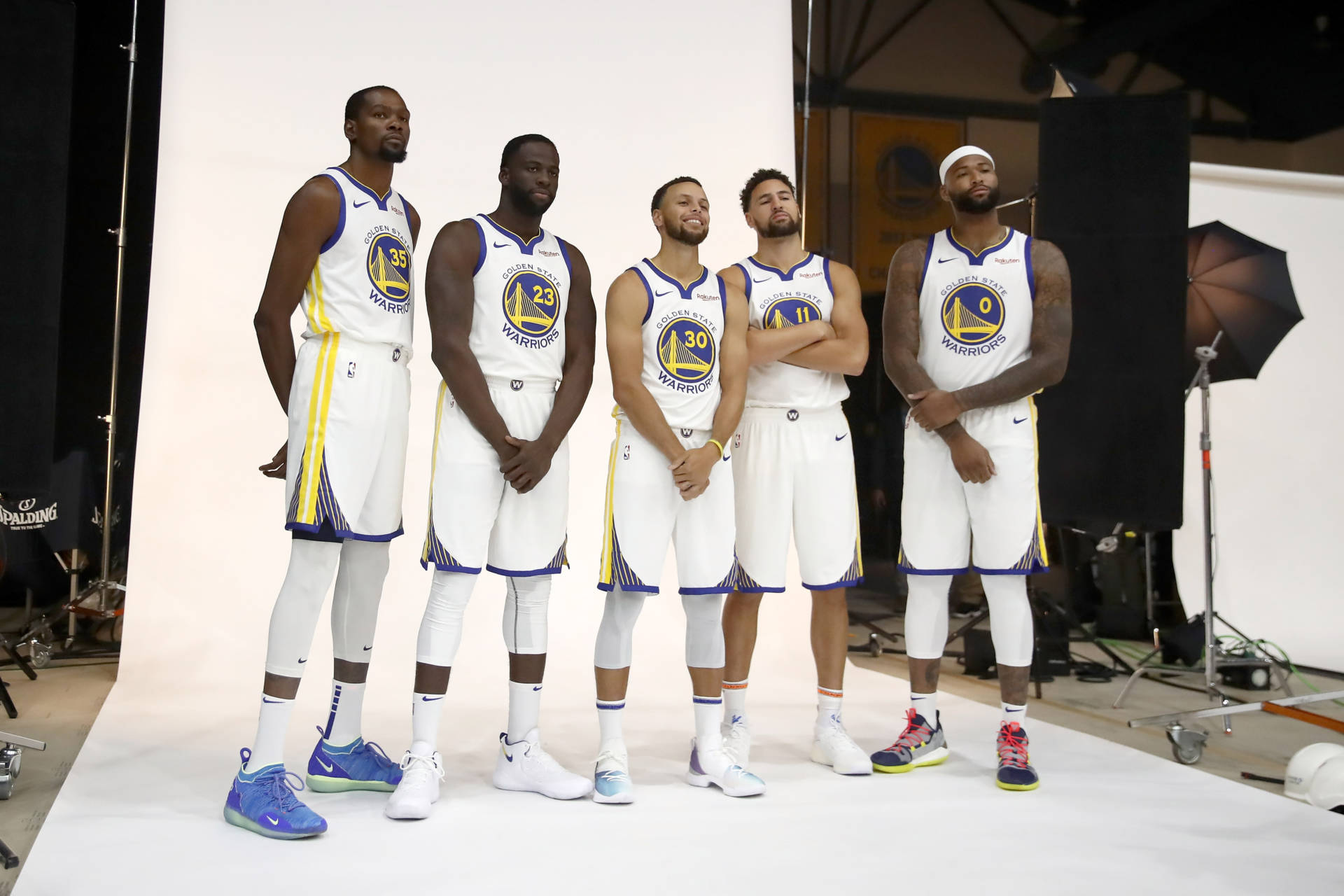 (From left) Kevin Durant, Draymond Green, Stephen Curry, Klay Thompson and DeMarcus Cousins pose at the Warrirors media day in September.  Ezra Shaw/Getty Images