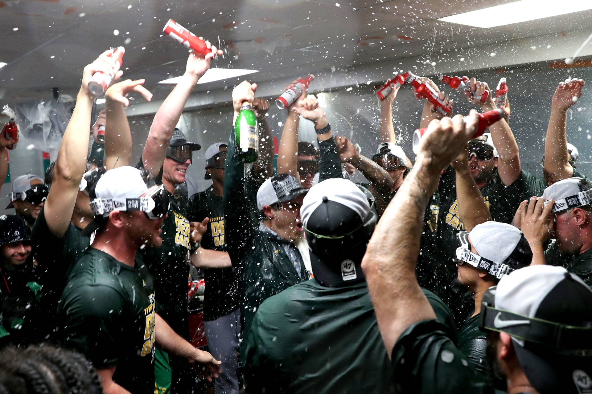 A's players celebrate clinching a spot in the playoffs after beating the Seattle Mariners on Sept. 24, 2018.  Abbie Parr/Getty Images