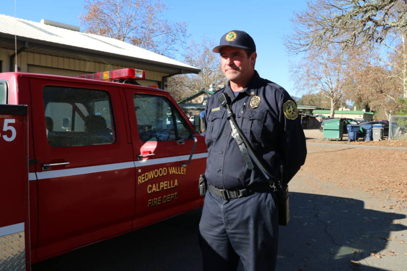 Brendan Turner stands by his fire truck behind the Redwood Valley Fire Department in Mendocino.