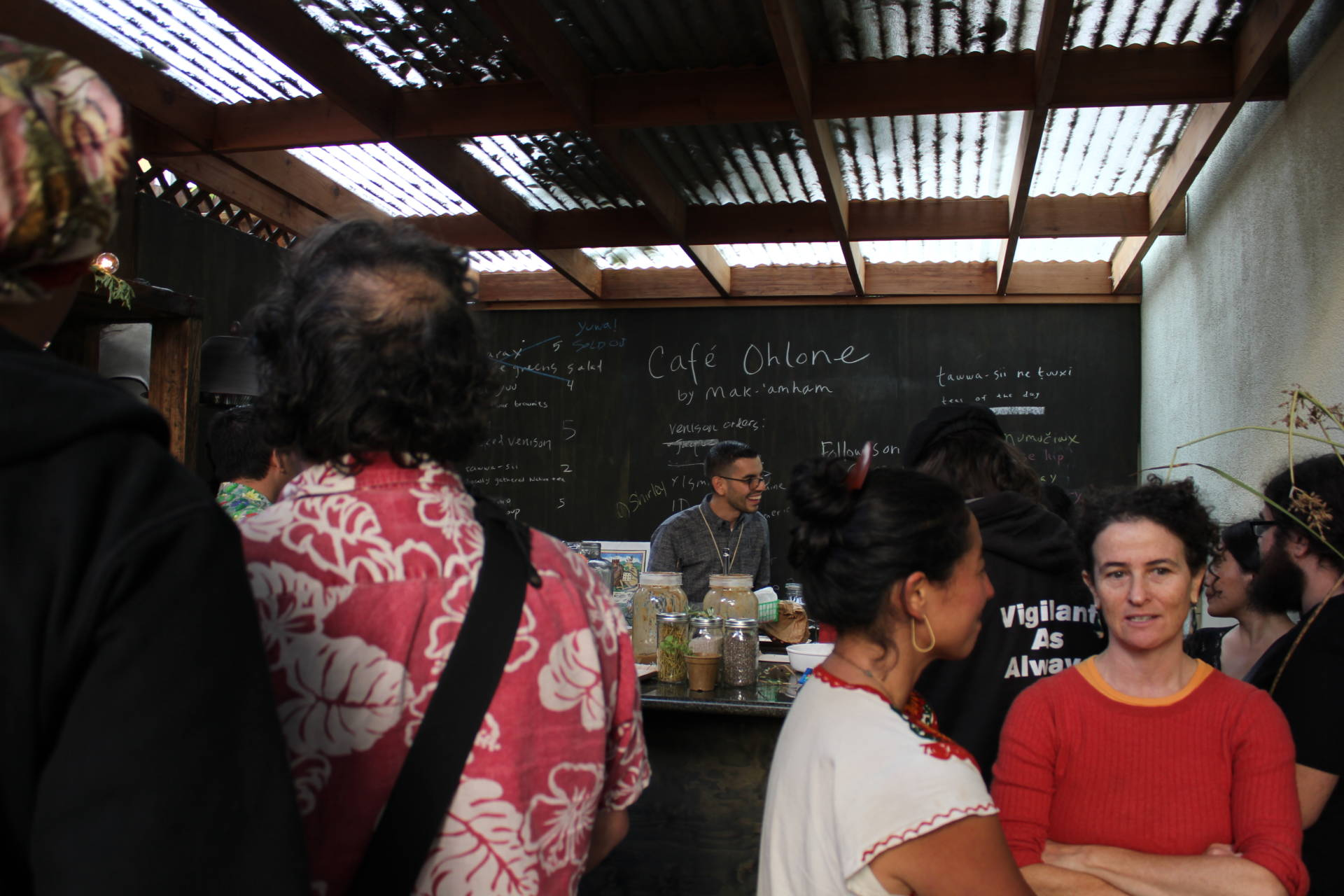 Cafe Ohlone co-owner Louis Trevino waits on a long line of eager diners at a preview tasting at the new Berkeley cafe. Sara Hossaini/KQED