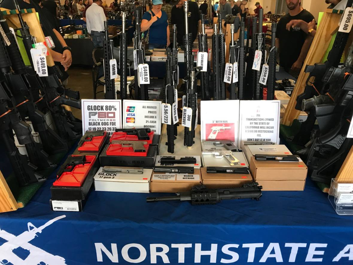 Gun Show Enthusiasts Offer Mixed Views on New Gun Laws