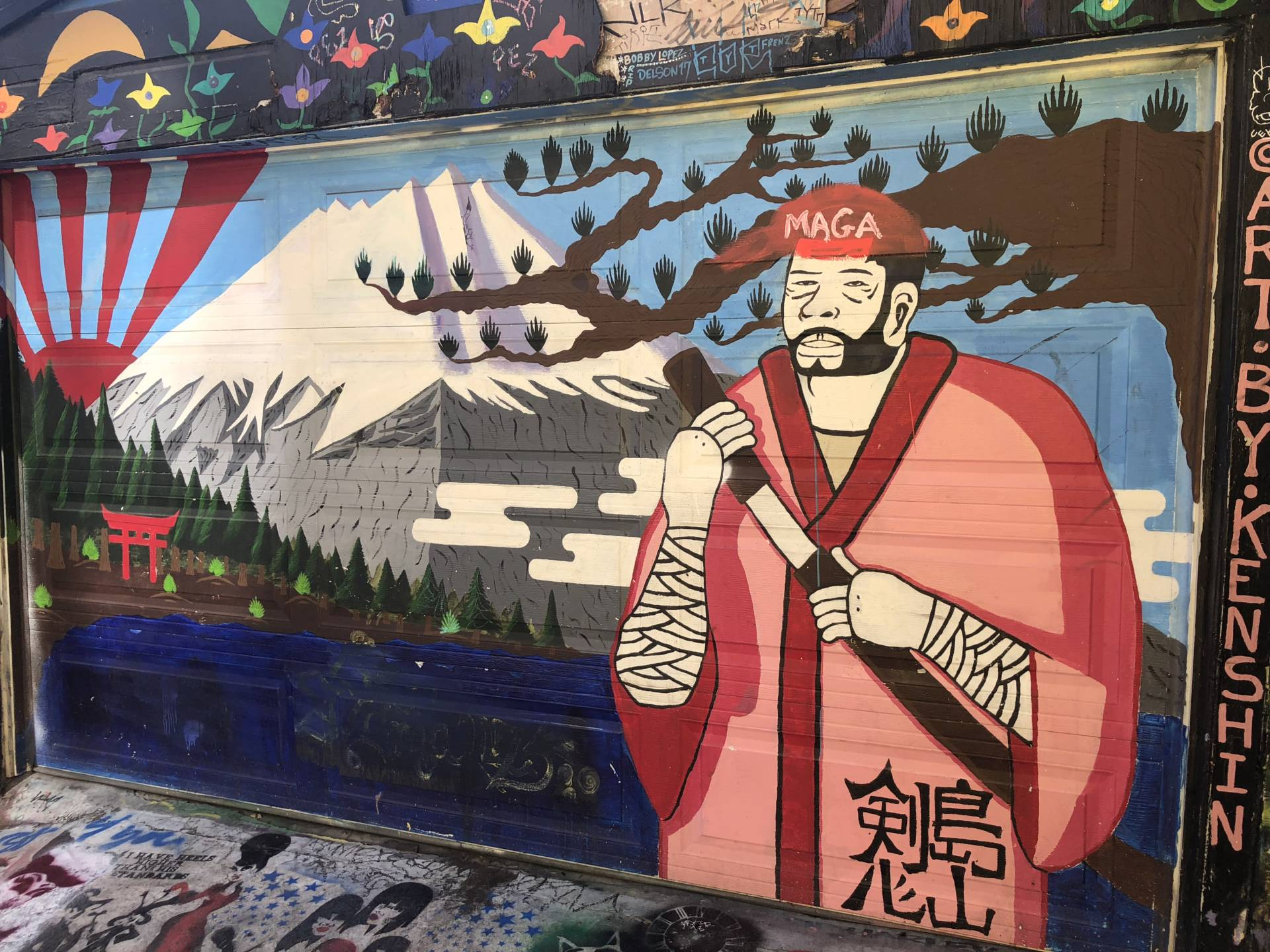 "Several murals were vandalized with ""Make America Great Again"" imagery. Tiffany Camhi/KQED"