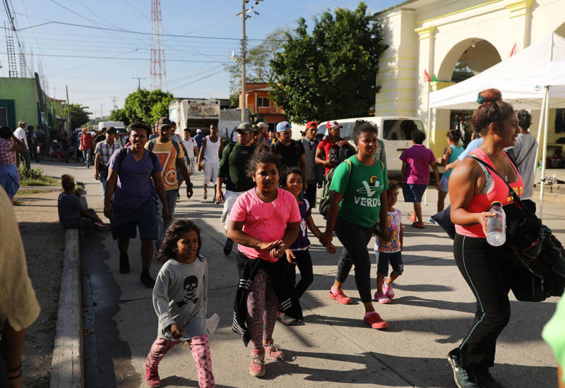 Some of the thousands of Central American migrants arrive into the small town of Santiago Niltepec on Oct. 29, 2018 in Santiago Niltepec, Mexico. Following a break on Sunday, the migrants, many of them fleeing violence in their home countries, resumed their march towards the U.S. border. As fatigue from the heat, distance, and poor sanitary conditions has set in, the numbers of people participating in the march has slowly dwindled, but a significant group are determined to get to the United Sates.