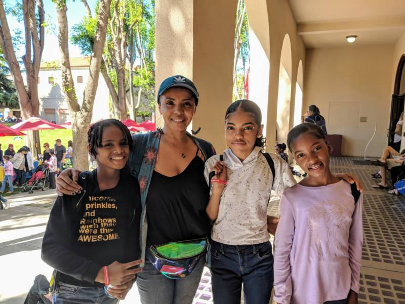 Tanya Akbar brought her two daughters and niece from Oakland to Girls' Festival. 'I thought it would be important for them to see young girls in entrepreneur and leader roles, and really see the importance of coming together and supporting and uplifting one another.'