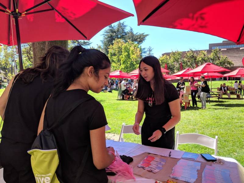 Aileen Zhong talks with visitors at Girls' Festival. Zhong is with Ignite, an organization in Oakland that supports women in politics. 'It's really important for young women to know why voting matters and why their voice matters so that they can become the next change-makers in their community.'