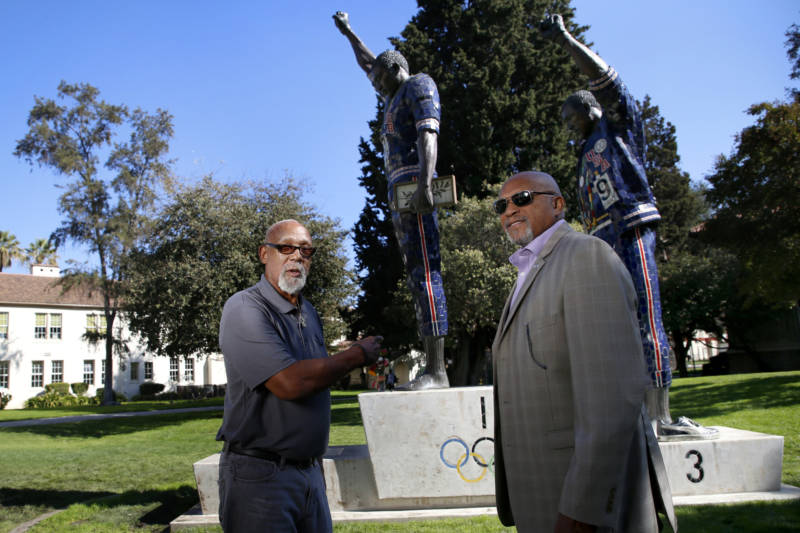 John Carlos and Tommie Smith stand in front of the statue memorializing their iconic Olympic moment on the San Jose State University campus.