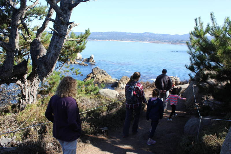 A family from Texas hikes through Point Lobos State Natural Reserve. One of the park's main jobs will be publicizing the new reservation rule as the park attracts visitors from around the world.