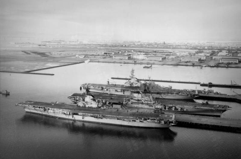 U.S. Navy aircraft carriers USS Hancock (CVA-19), USS Midway (CVA-41), and USS Bon Homme Richard (CVA-31) berthed at Naval Air Station Alameda in 1958.