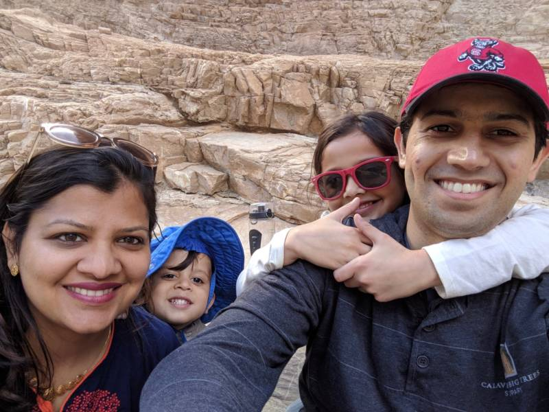 "Leena Bhai with her family on vacation in 2018 at Death Valley. Her husband Siddharth has a job at Google and an H-1B visa, but because of the years-long wait time Indian applicants face for an employment-based green card, the Bhais feel like they may have to give up on their ""American dream."""