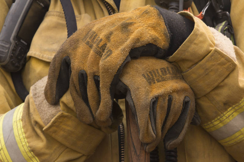 A firefighter holds a hand tool ready to build containment around the Ranch Fire.