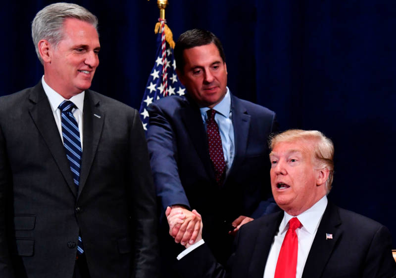 President Trump shakes hands with Rep. Devin Nunes as House Majority Leader Kevin McCarthy looks on, after signing a presidential memorandum focused on sending more water to farmers in the Central Valley.
