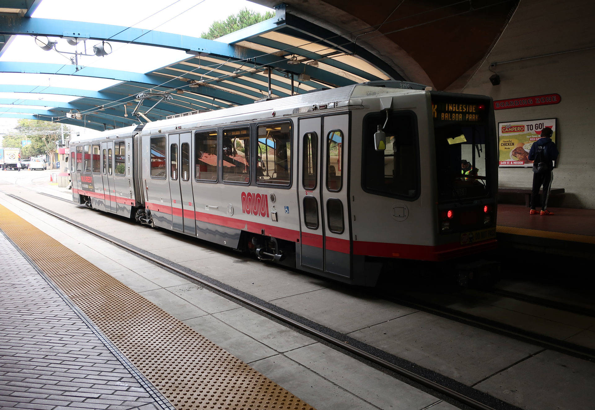 Riders wait to ride a Muni train at the reopened Twin Peaks Tunnel in San Francisco. On Aug. 10, a worker with Shimmick Construction was killed by a falling steel beam while working on the tunnel project. Michelle Wiley/KQED