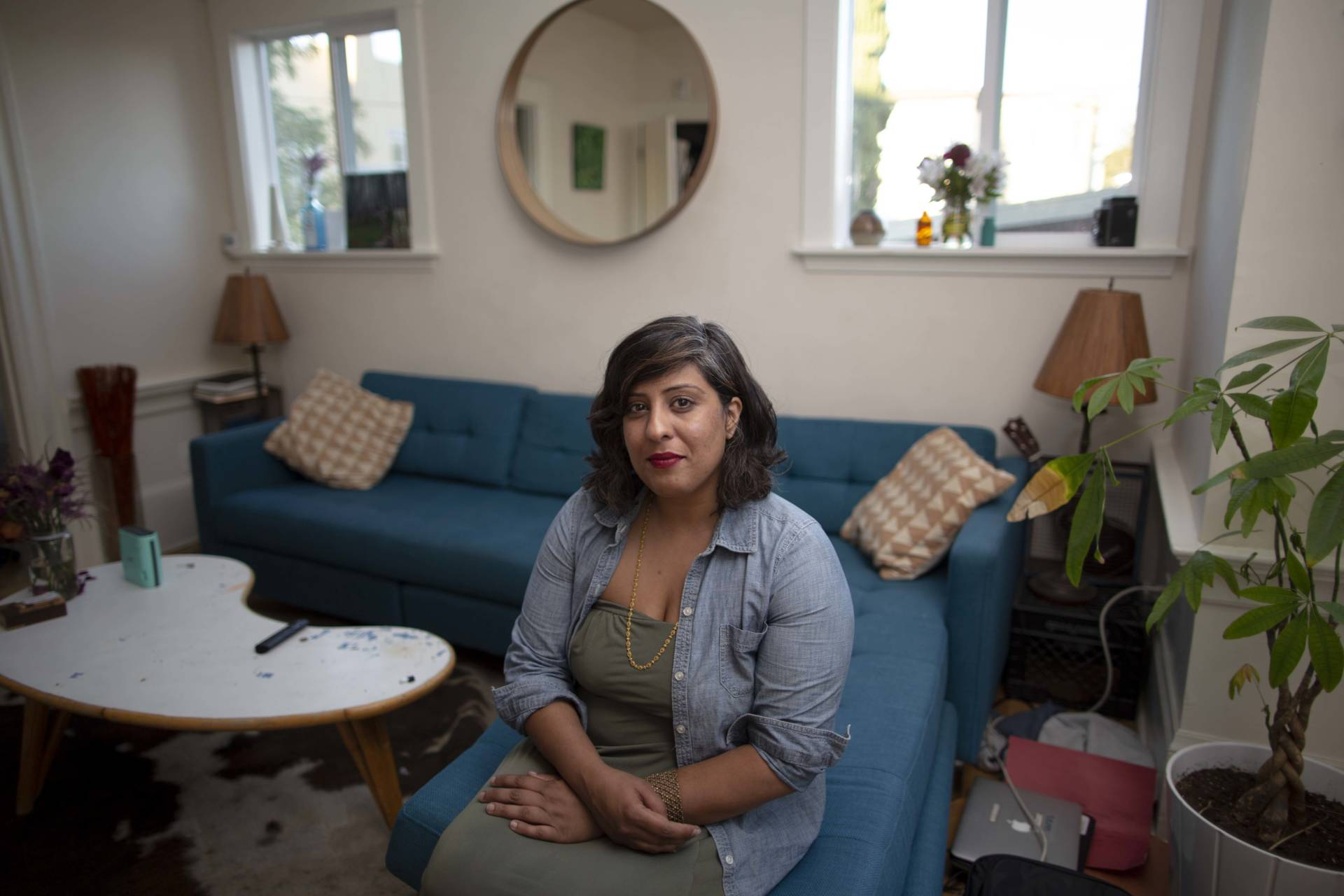 Jas Johl in the living room of her home in North Oakland. Johl pays about $13,000 a year in property taxes, far more than many of her neighbors. Sean Havey for California Dream