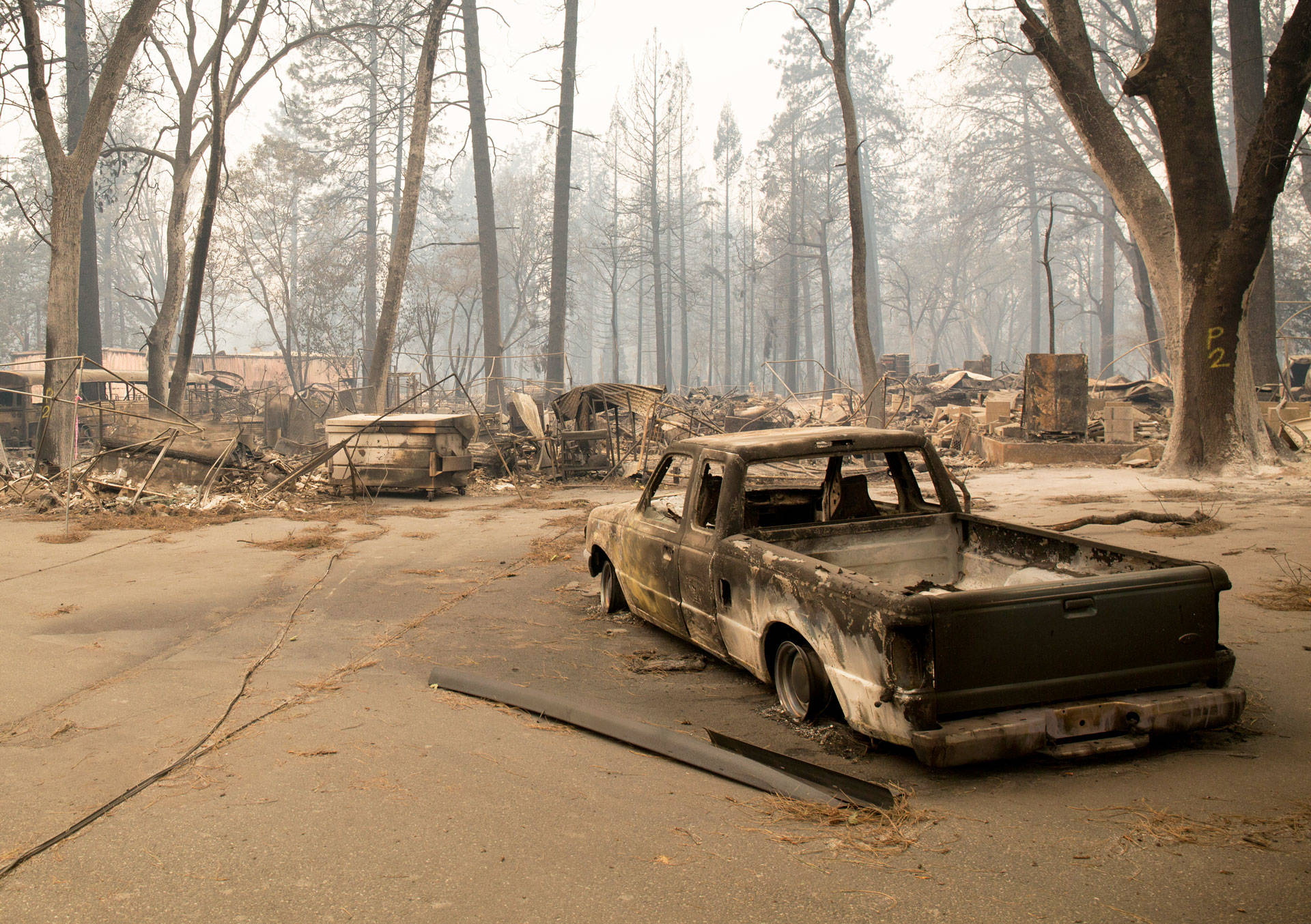 The site of Paradise Army Surplus on Nov. 13, 2018, after the Camp Fire decimated the area. Anne Wernikoff/KQED