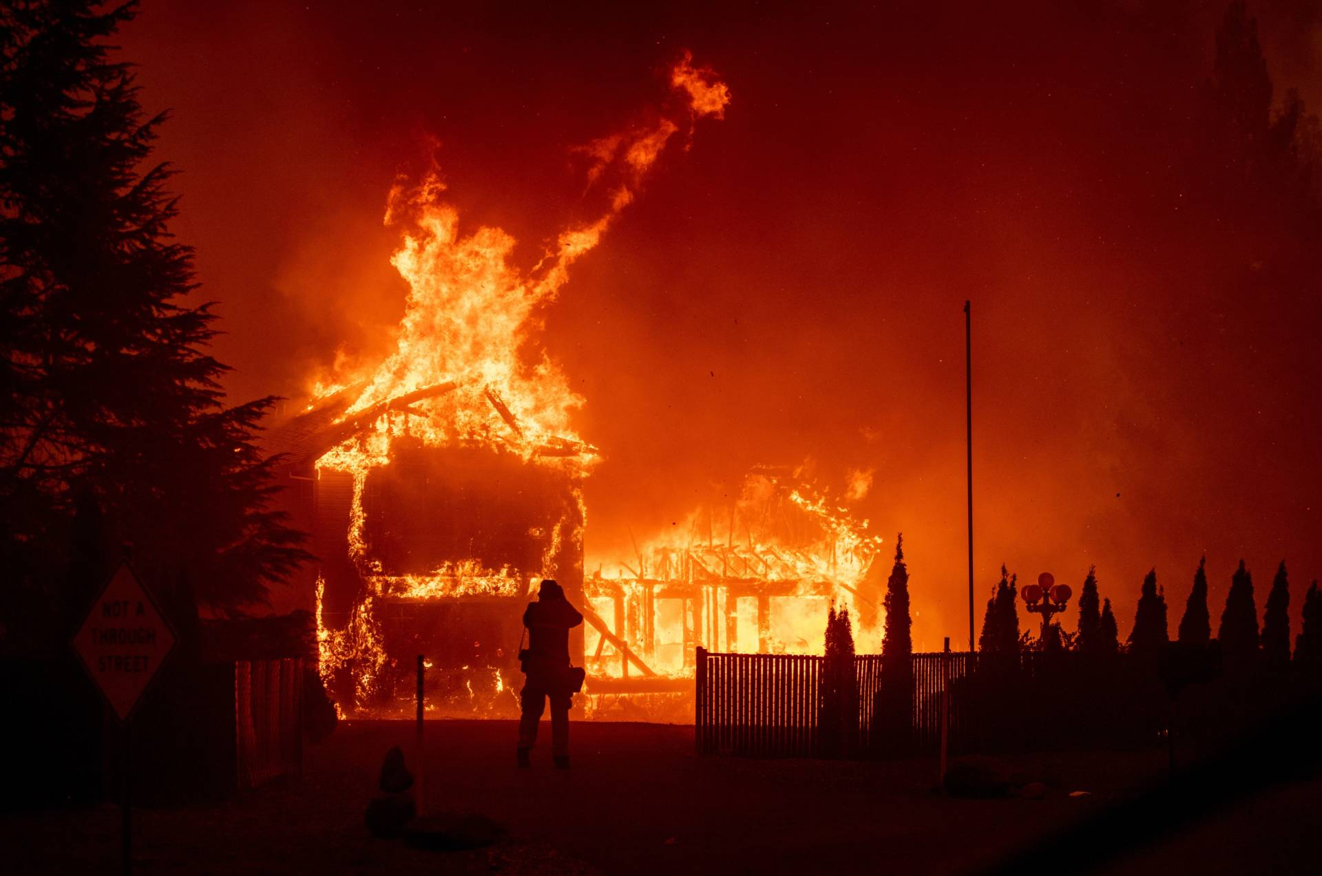 A home burns during the Camp Fire in Paradise, California on Nov. 8, 2018. Josh Edelson/AFP/Getty Images