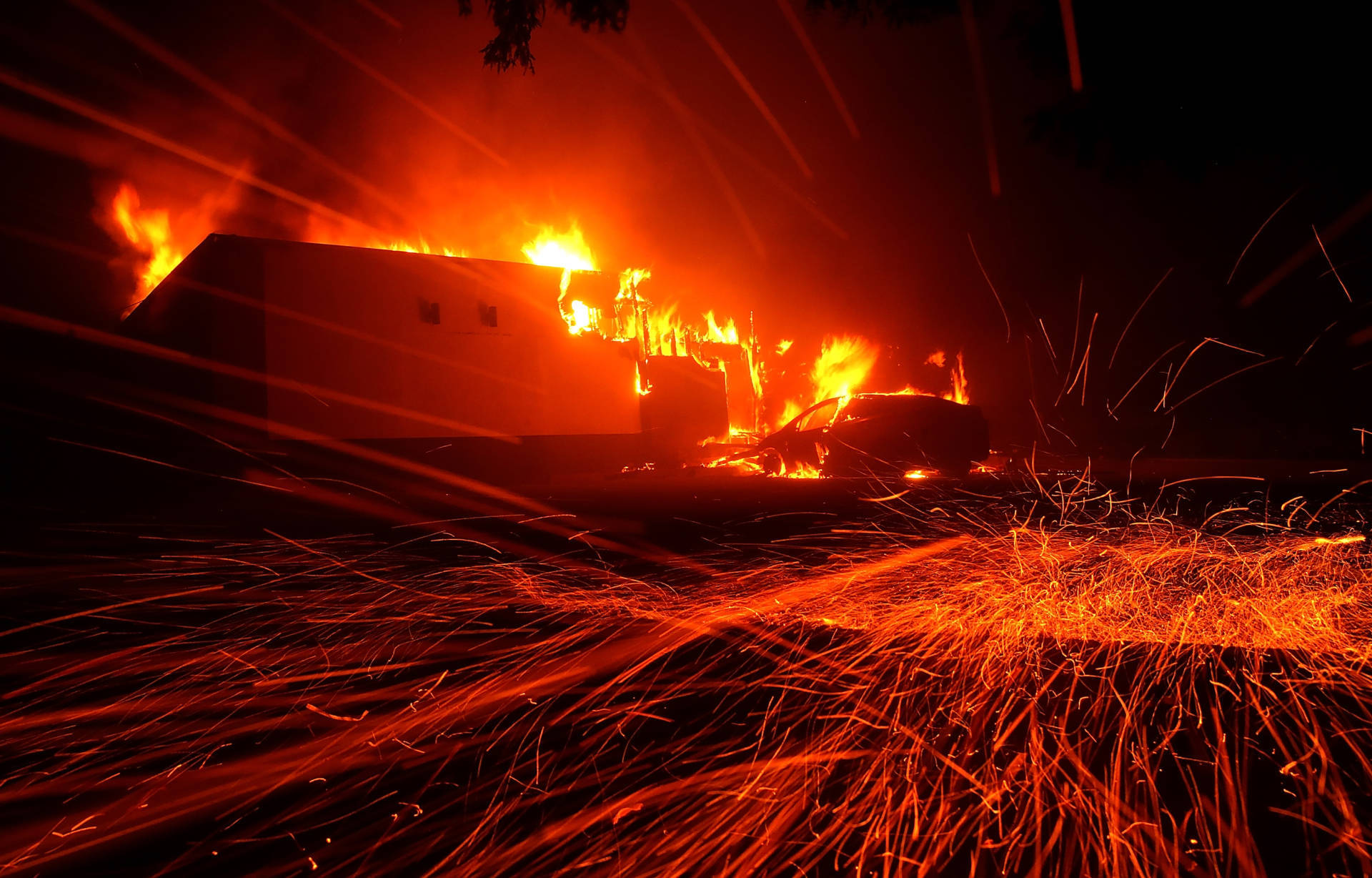 Embers blew in the wind as the Camp Fire burned a KFC restaurant Thursday night in the Butte County town of Paradise. Justin Sullivan/Getty Images