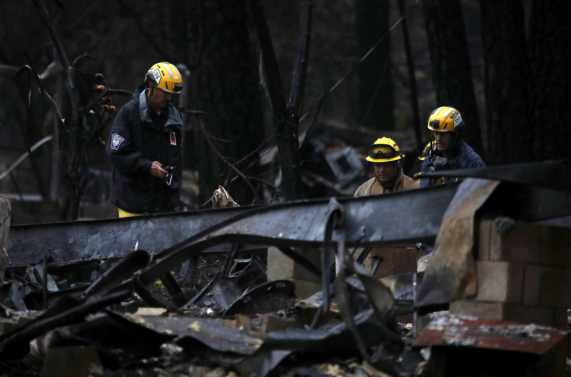 A crew searches for human remains in the ruins of a residence destroyed by the Camp Fire. Search teams have combed through nearly 18,000 structures and located 88 victims of the blaze, the deadliest and most destructive in California history.  Justin Sullivan/Getty Images