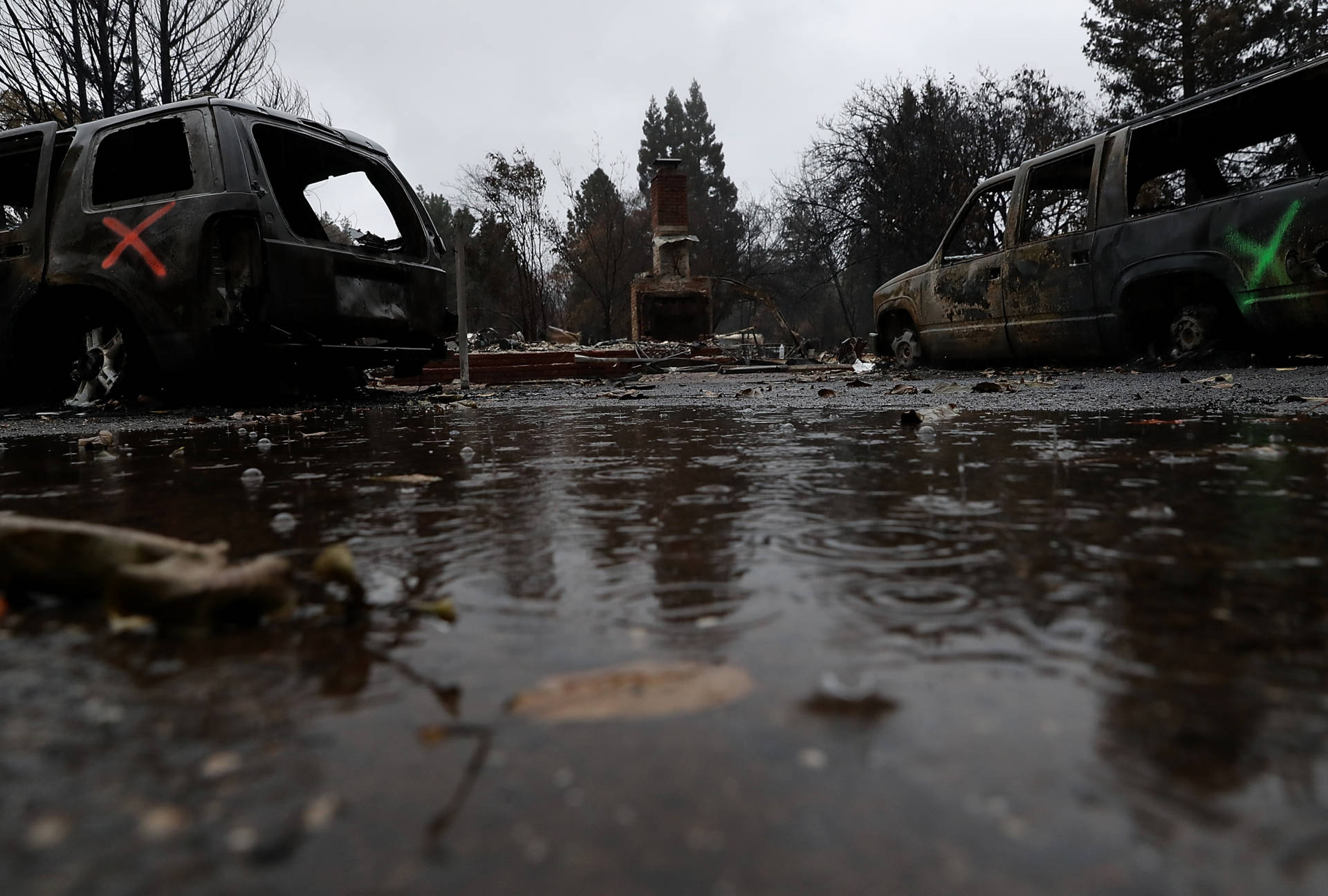 Rain falls on a home destroyed by the Camp Fire on Nov. 22, 2018 in Paradise. Justin Sullivan/Getty Images