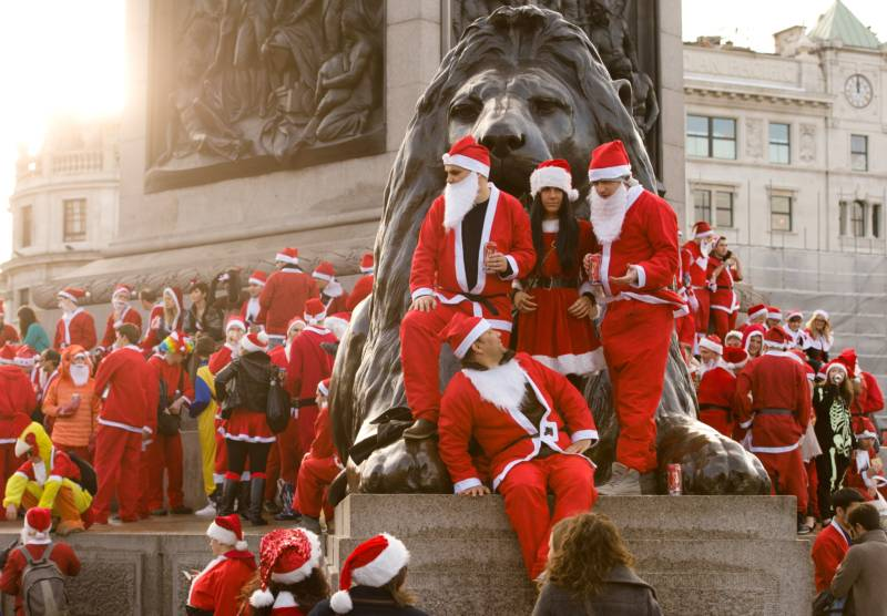 Revellers in Santa costumes gather around Nelson's Column during a 'Santacon' in Trafalgar Square in central London.