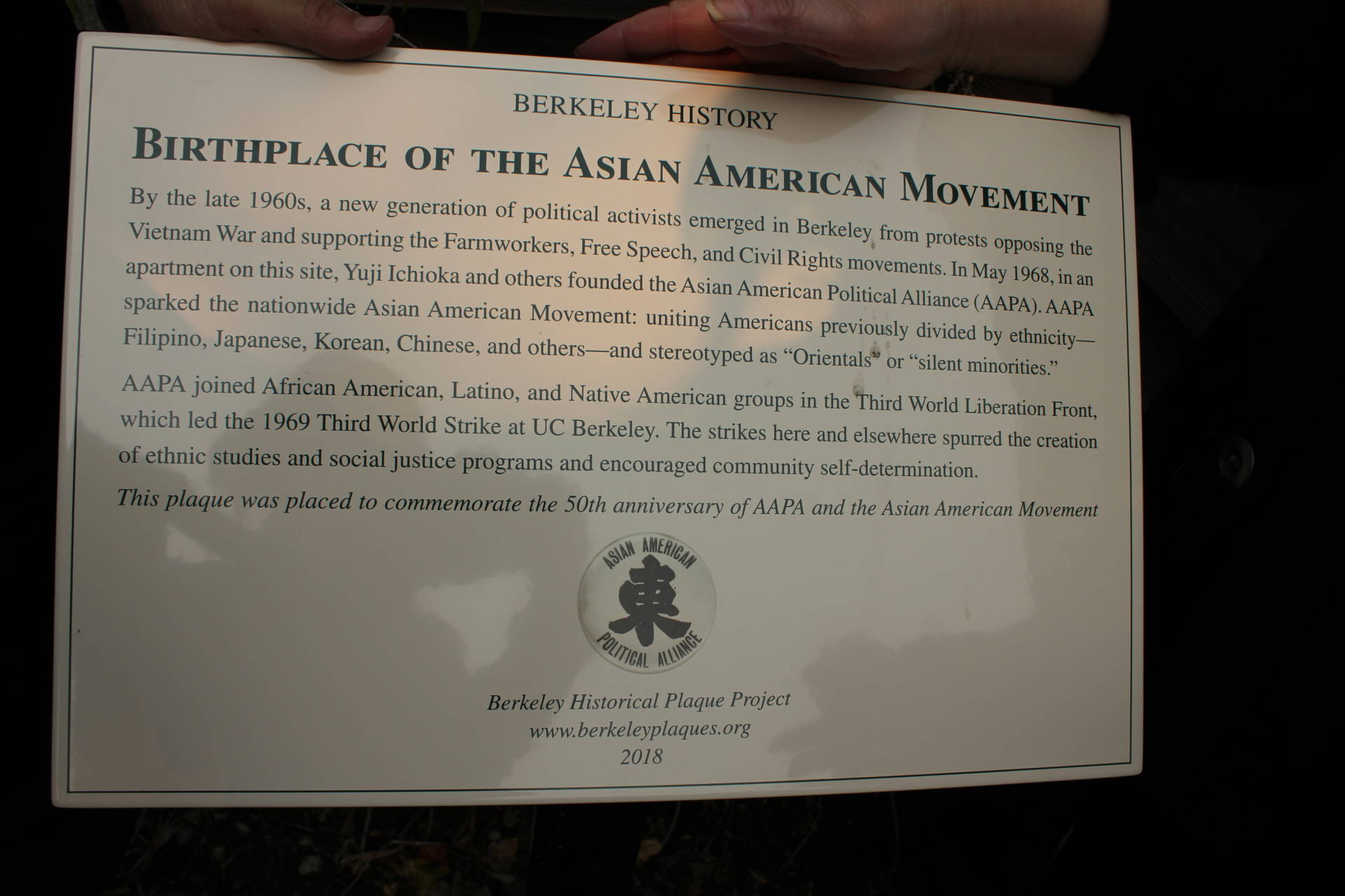 A Berkeley plaque commemorating the 50th anniversary of the founding of the Asian American Political Alliance, which coined the term Asian American and sparked a movement.