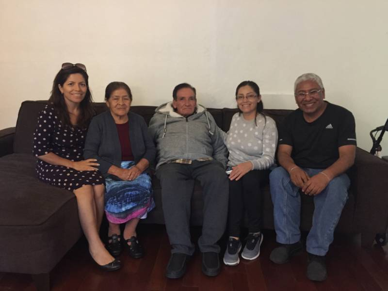 Marisol Necochea (L) sits with her parents, sister and brother-in-law in Santa Clara.