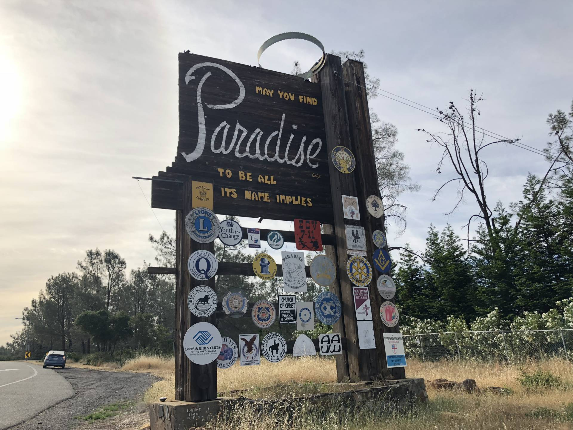 "The sign that welcomed those driving into Paradise read, ""May you find Paradise to be all its name implies."" That sign burned down this week. Laura Klivans/KQED"
