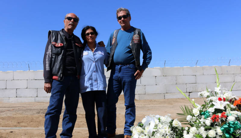 Raymond Mata's fiance at the time of his death, Vira Flores, and his friends Mike Simpson and Skip Morgan, stand next to the mass grave where Mata was buried in Fresno. Mata died in a suicide in 2013 and was buried on September 13, 2018.