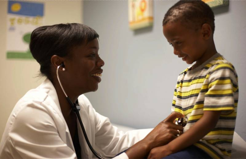 Dr. Nadine Burke Harris and a patient.