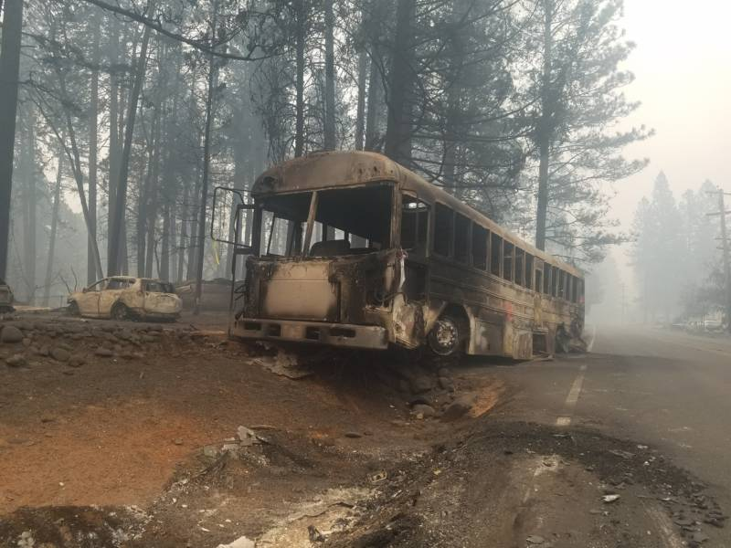 A burned bus sits along Skyway road in Paradise on Nov. 13.
