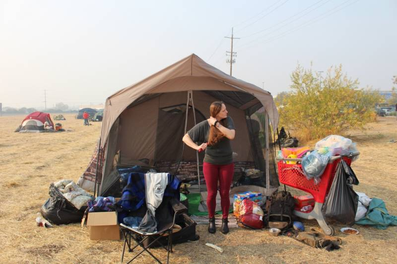Djara German has lived in that tent with three other people for eight days in a lot next to the Walmart in downtown Chico.