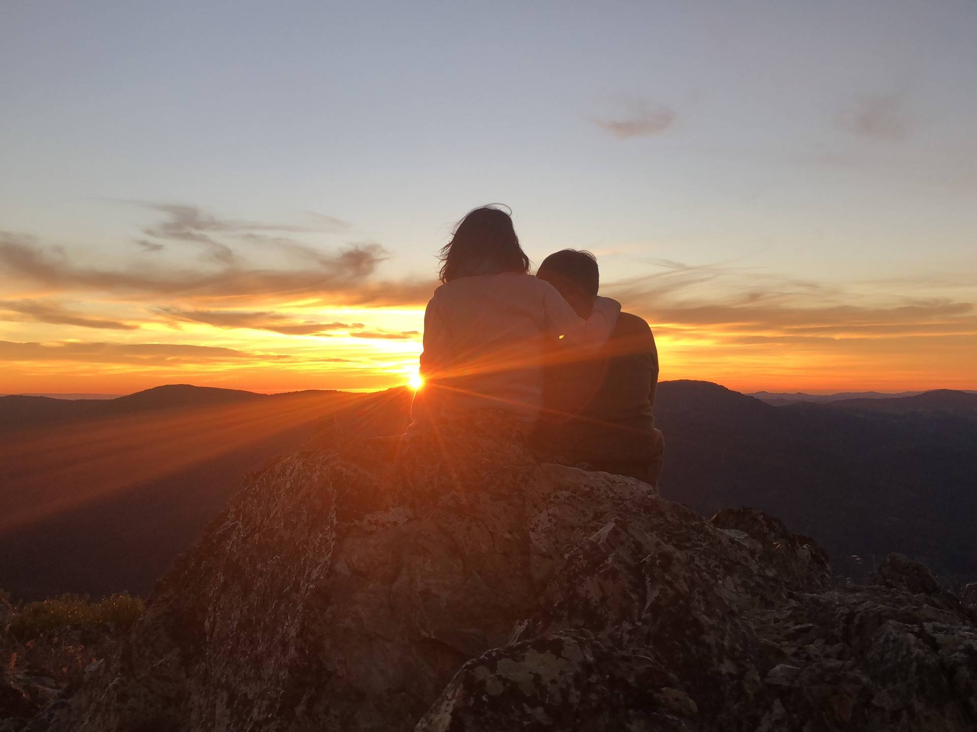 Tiffany Camhi and her boyfriend sit on top of Monkey Rock in Mendocino National Forest. The rock formation was spared from the Mendocino Complex Fire. Tiffany Camhi/KQED