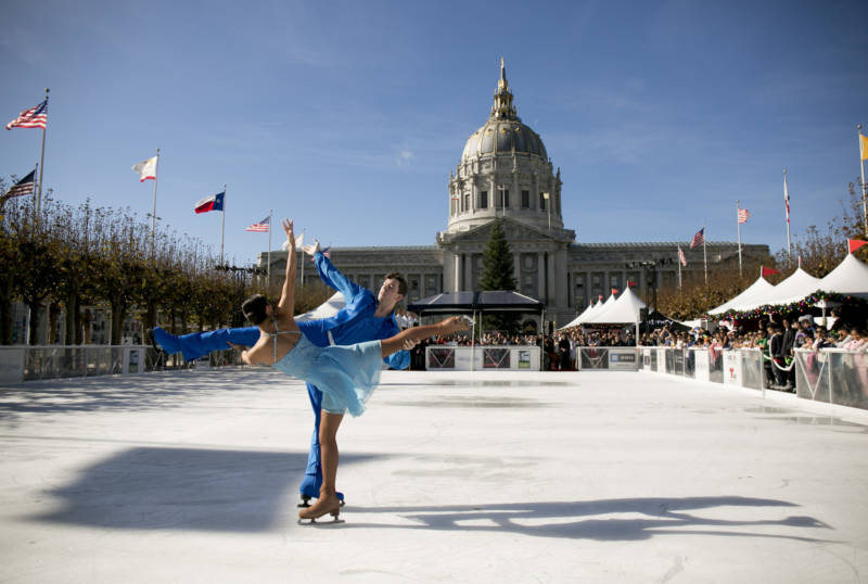 Figure skating team Cali Fujimoto and Nick Barsi-Rhyne perform a duet in front of City Hall on Nov. 30, 2018.