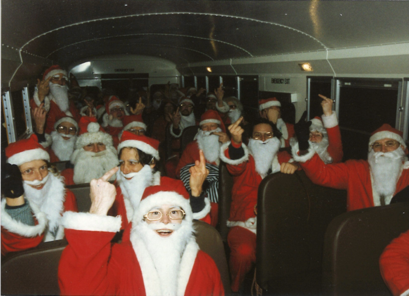 Rob Schmitt rented a bus for the Cheap Suit Santas to roam the streets of San Francisco.
