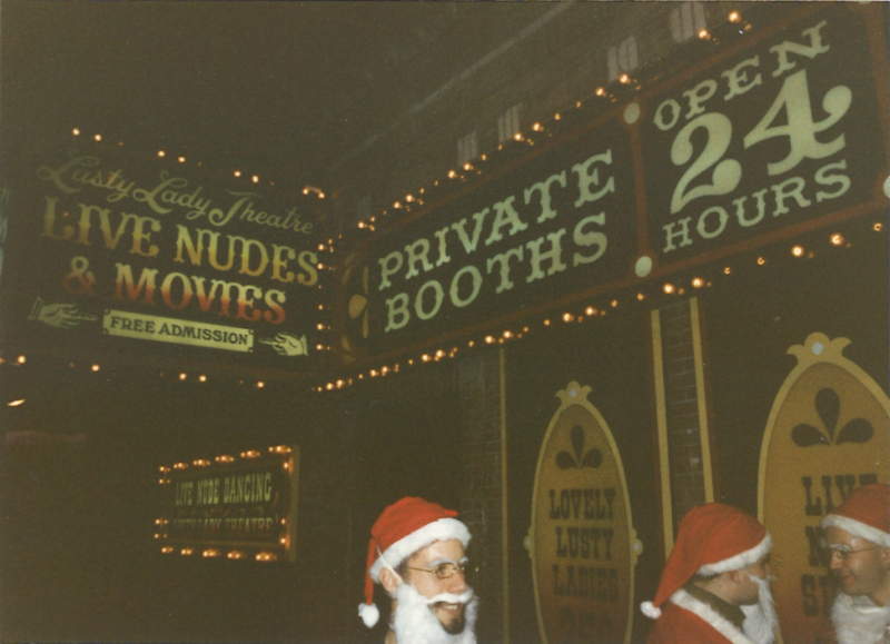 Santas headed into the Lusty Lady, a unionized strip club.
