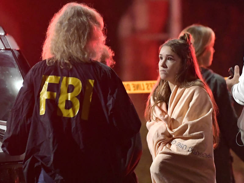 "An FBI agent talks to a potential witness to the shooting at the Borderline Bar and Grill in Thousand Oaks, where a gunman opened fire inside the country dance bar on ""college night."""