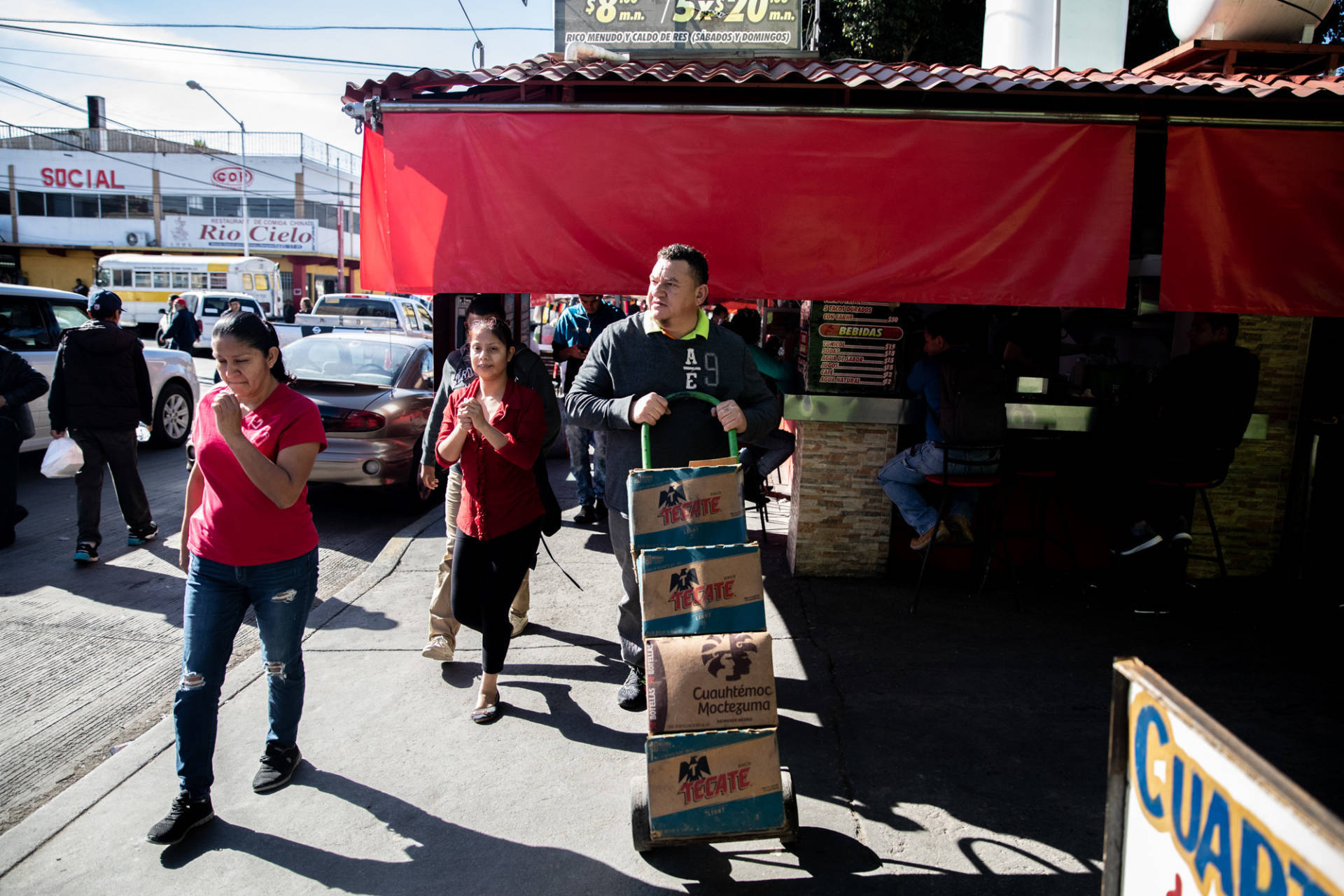 José Aguilar heads to the store on a supply run in Tijuana, Mexico. His restaurant Honduras 504 has become a community center for Honduran legal residents and unauthorized migrants alike. Tomás Ayuso for NPR