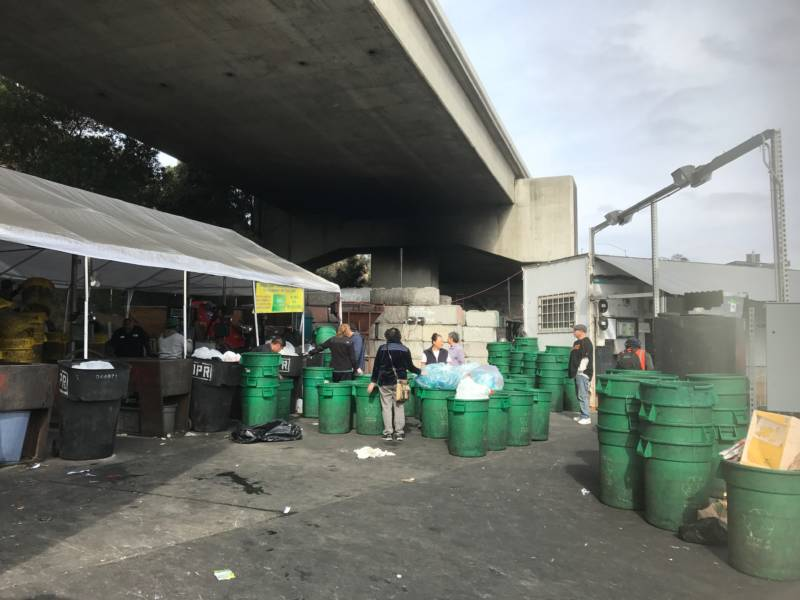 Customers line up with their bins of recyclables at Our Planet Recycling SF.