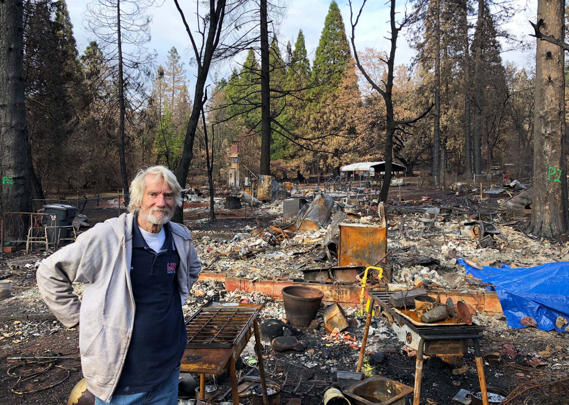 Don Clark stands in front of where his home was in Paradise. It was destroyed by the Camp Fire. Jeremy Siegel/KQED