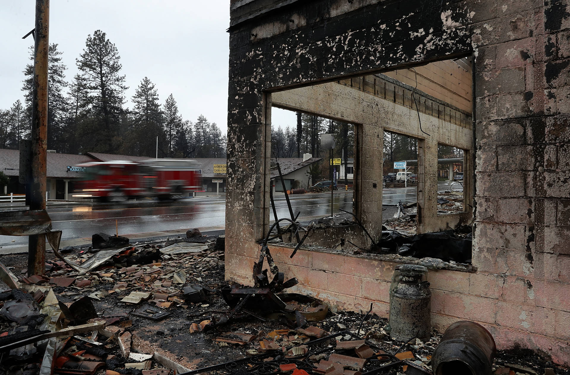 A fire truck drives by a business that was destroyed by the Camp Fire in Paradise. Justin Sullivan/Getty Images