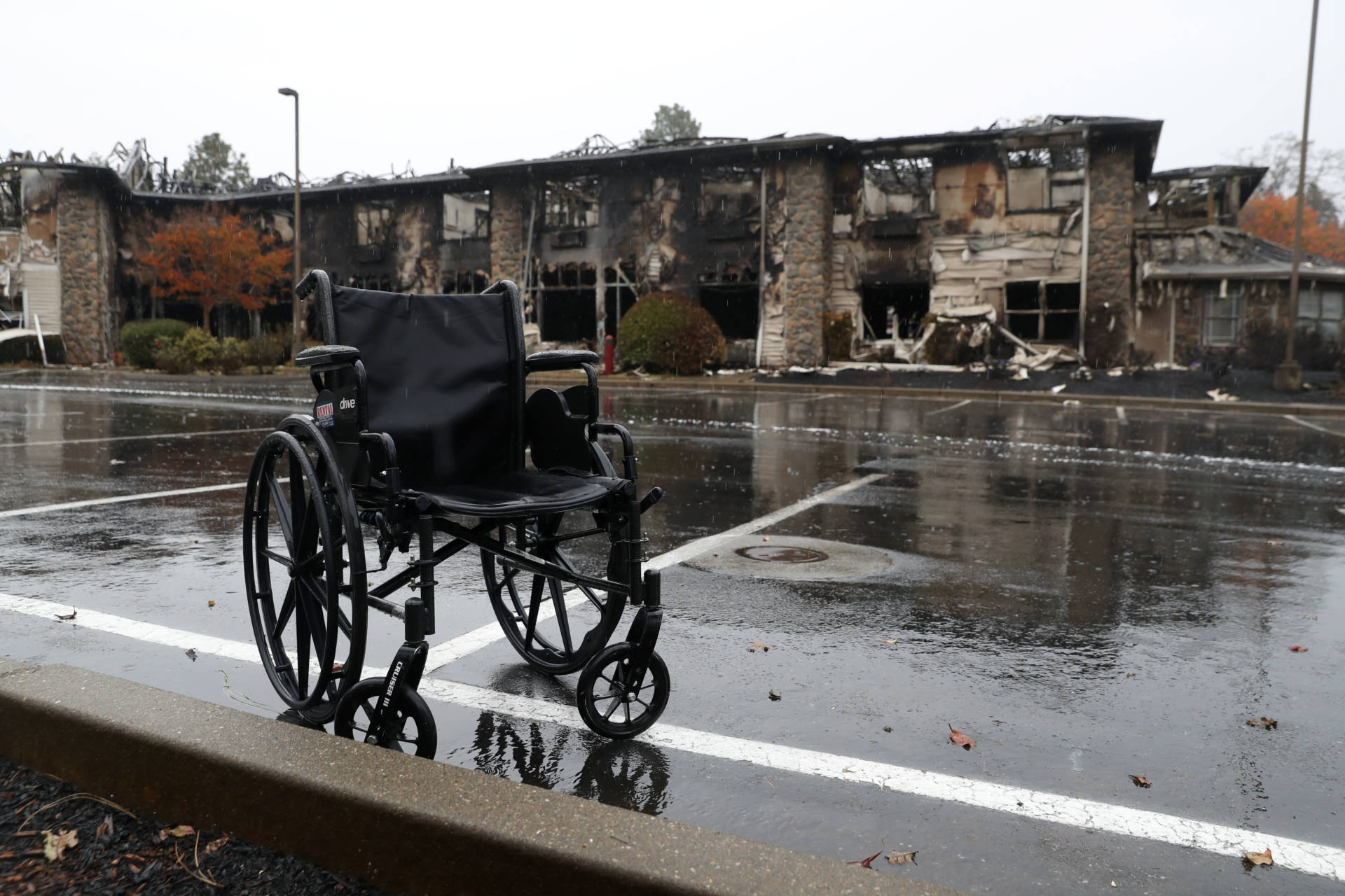 A wheelchair sits in front of a senior living facility that was destroyed by the Camp Fire. The fire killed at least 85 people and destroyed about 14,000 homes.  Justin Sullivan/Getty Images