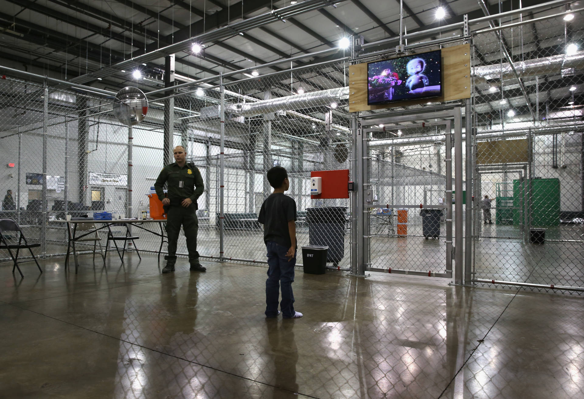 A boy from Honduras watches a movie at a detention facility run by the U.S. Border Patrol on September 8, 2014 in McAllen, Texas.  John Moore/Getty Images
