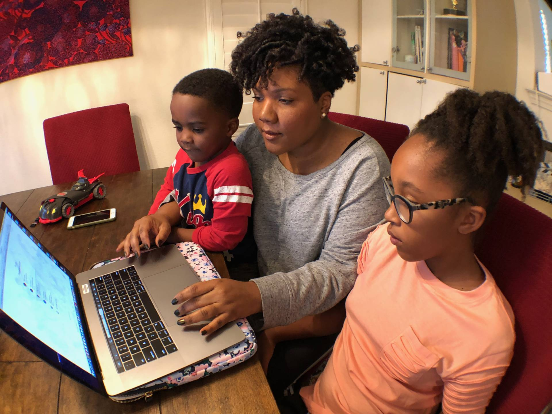 "Tonya Mosley and 11-year-old Audrey check her assignments and work progress through the school portal ""School Loop.""  Courtesy of Tonya Mosley/KQED"