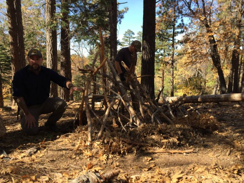 Instructors Denny Salisbury and Joe Hernandez demonstrate how to build shelter.