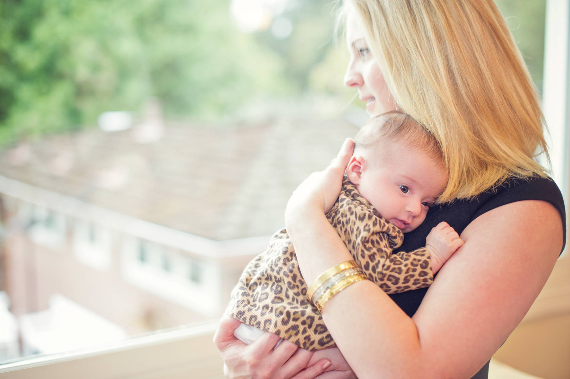 Lisa Abramson holds her daughter, Lucy.  Claire Mulkey