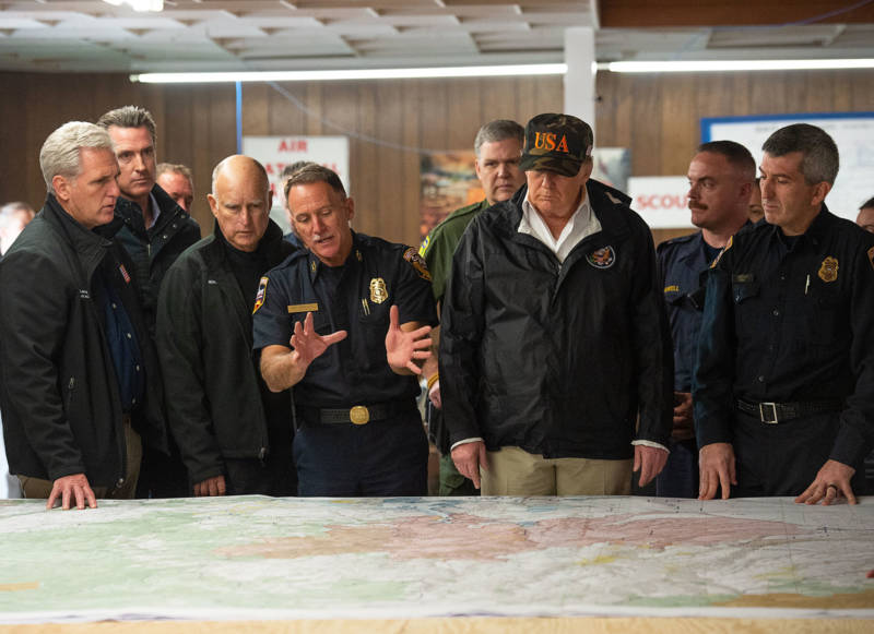 Rep. Kevin McCarthy, Gov. Jerry Brown, Gov.-elect Gavin Newson and President Donald Trump listen to Cal Fire Chief Ken Pimlott during Trump's visit to the Camp Fire in Chico on Nov. 17, 2018.