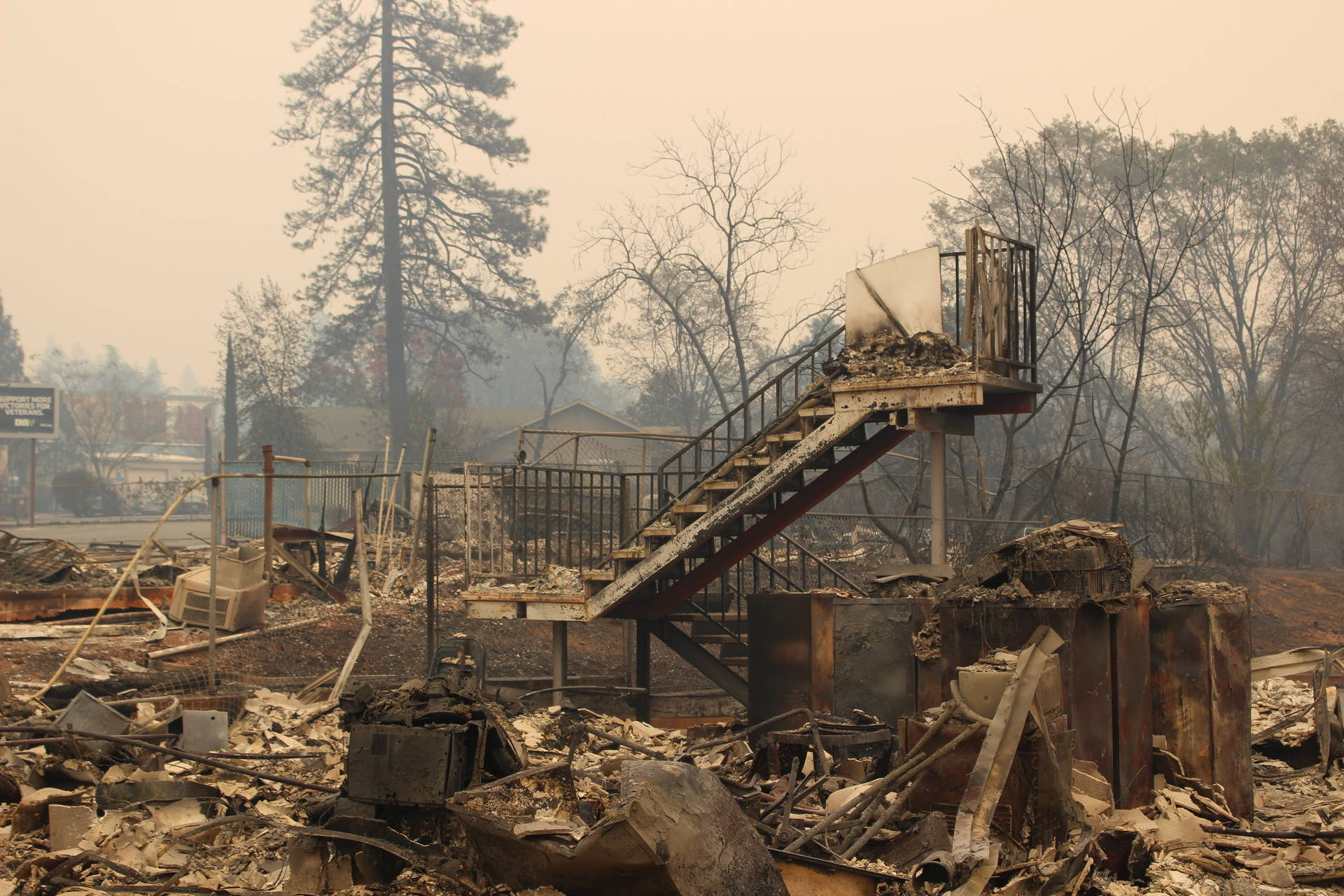 The debris left behind by the Camp Fire in Butte County will take a year to clean up.  Danielle Venton/KQED