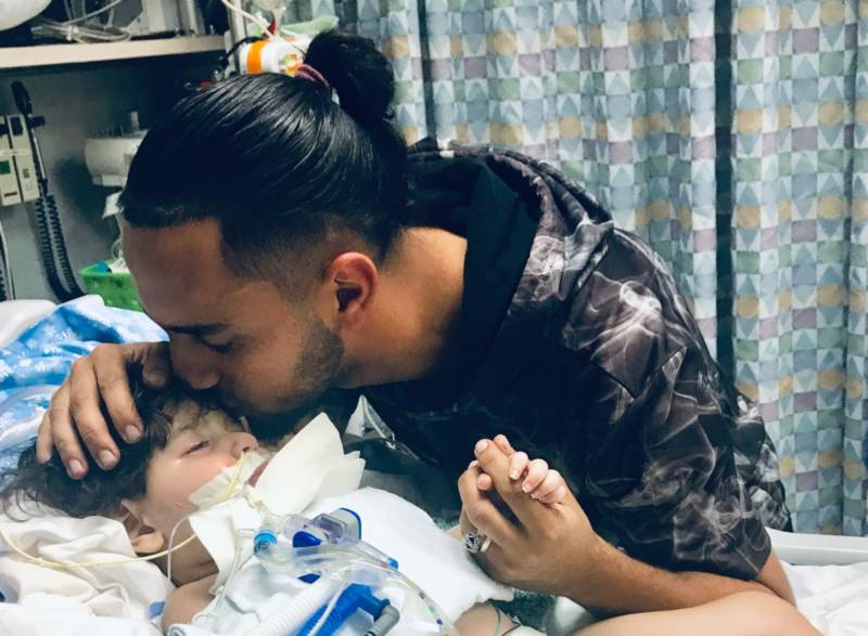 Ali Hassan with his son at the UCSF Benioff Children's Hospital in Oakland.